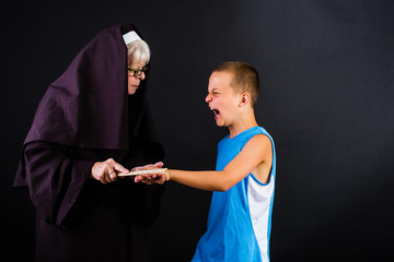 Nun punishing young boy