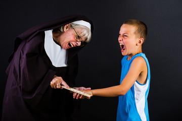 nun hitting a boy