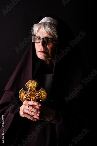 nun holding a cross