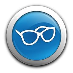 lunettes sur bouton bleu