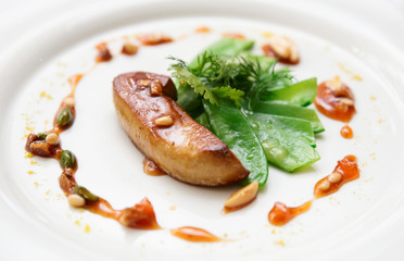 Fried foie gras with caramelized nuts and vegetables