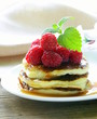 homemade pancakes with berries and mint -healthy breakfast
