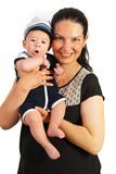 Mom holding amazed baby