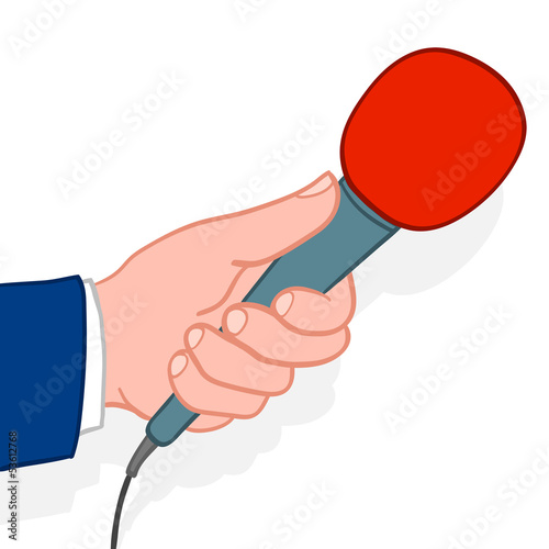 Man holding out a microphone