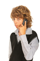Teen boy talking by phone