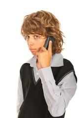 Teen boy talking by phone