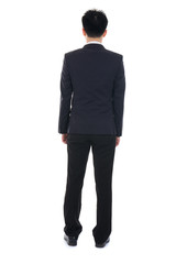back view of Business man looks ahead. Young guy in black suit w