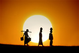 silhouette of traditional asian farmer coming back from a harves