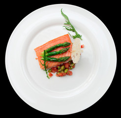Slow cooked salmon steak in plate, isolated