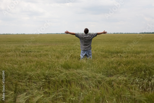 young farmer in a wheat field