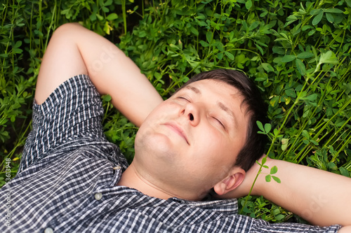 man sleeping on the grass