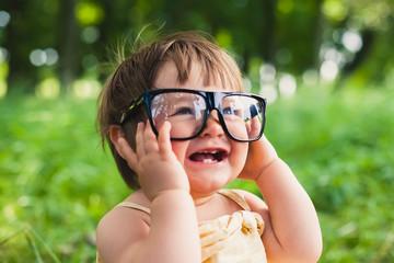 little girl  in  glasses on nature