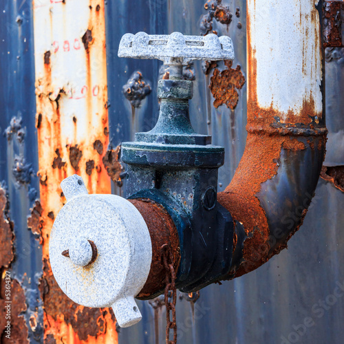 rusty water valve and tank