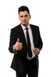 Handsome young businessman showing the thumbs up sign