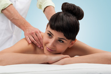 Peacefull and beautiful woman getting a massage from a man, layi