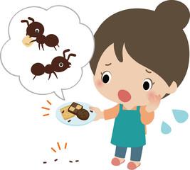 家の中で蟻を見つけて困っている女性
