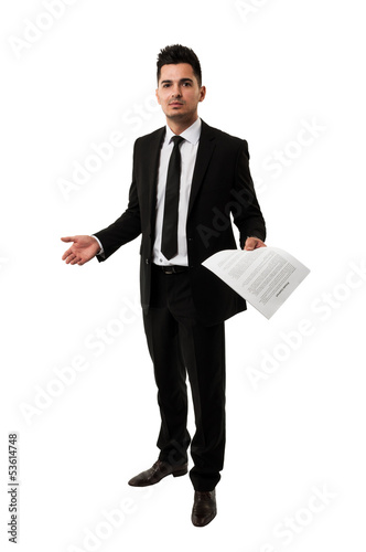 Tall businessman waiting for a client to sign a contract