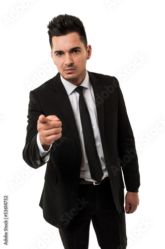 Tall businessman pointing the inger at you
