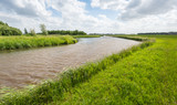 Curved stream in an agricultural landscape in the Netherlands