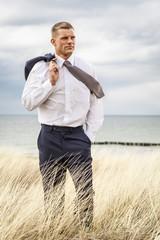 Geschäftsmann am Strand