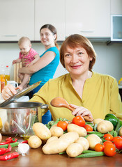 Mature woman cooking veggie lunch in kitchen