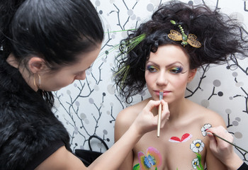 model preparation to shooting in style bodyart
