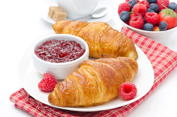 delicious breakfast - fresh croissant with raspberry jam
