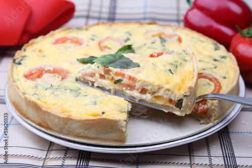 Quiche with tomatoes and basil
