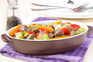 Braised meat stew with beef and vegetables in pot
