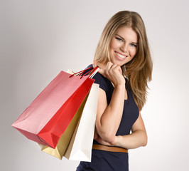 Young beautiful female shopper with shopping bags.
