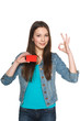 Young teen female showing blank credit card and gesturing OK