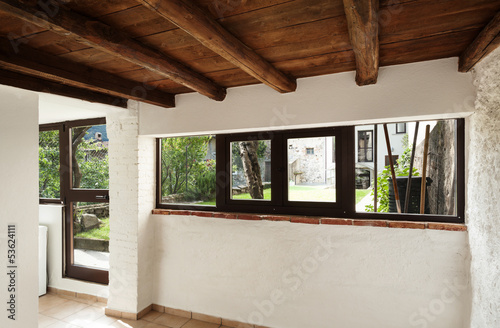 interior rustic house, entrance door, view garden
