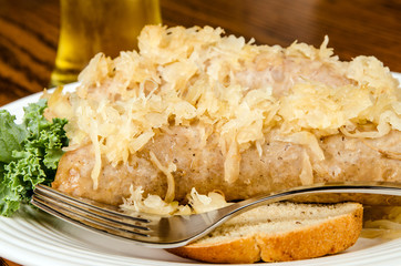 Baked bratwurst with sauerkraut on rye bread