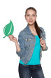 Casual denim teen female holding green leaf symbol