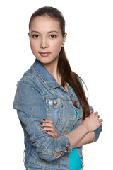 Portrait of a casual denim teen girl with folded hands