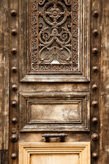 Old wooden door with metal handle