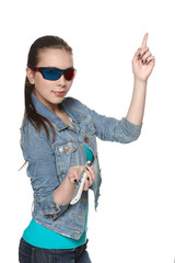 Female in 3D glasses holding TV remote control, pointing up