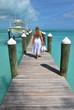 Girl on the yacht pier. Exuma, Bahamas