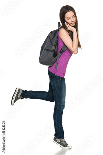 Full length of female with backpack talking on cell phone