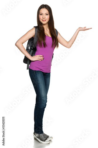 Casual girl wearing backpack showing copy space on palm