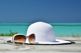 Hat and sunglasses on the beach of Exuma, Bahamas