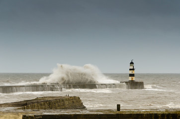 Seaham lighthouse with crashing waves