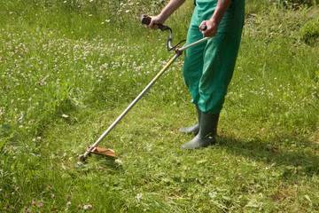 Cutting grass with a machine
