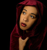 Gorgeous African American woman wearing a burgundy velvet shawl
