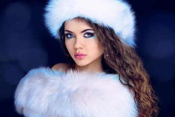 Beautiful Girl in Fur Coat and Furry Hat. Fashion Model. Winter