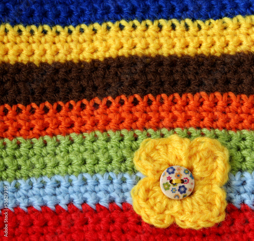 part of colorful knitted wool with knitted flower