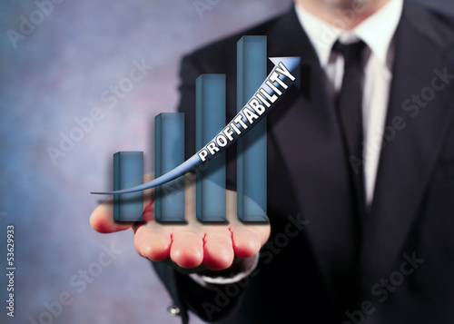 Businessman Holding Profitability Bar Graph