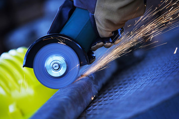 Angle grinder cutting steel