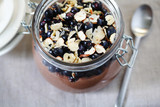 Blueberries with hazelnuts with chocolate pudding in a jar