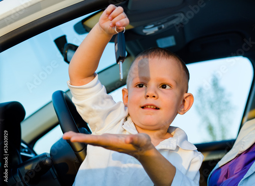 Little boy playiing with car keys